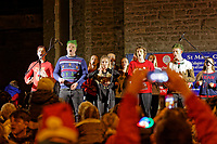 "Pictured: Youngsters sing outside St Mary's Church during the Christmas parade in Swansea, Wales, UK. Sunday 19 November 2018<br /> Re: Swansea Christmas parade attended by thousands has been branded a ""shambles"" for having just three floats.<br /> The annual festive event in south Wales, which took place on Sunday, promised ""dynamic dance-troupes"" as well as ""spectacular shows and stages"".<br /> But the parade was scaled down, leading to a barrage of criticism on social media because of roadworks in the city centre. <br /> The leader of Swansea Council, Rob Stewart apologised on Facebook and said the parade was not ""good enough"".<br /> Parents took on social media to voice their anger, calling the event ""a load of rubbish"" and claiming there was nothing for young children apart from ""a loud music float with Santa on""."