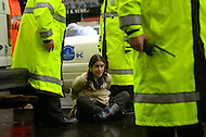December 7, 2011  (Washington, DC)  A woman sits calmly after she was arrested for defying police orders during an OccupyDC protest. She was one of four dozen or more arrested after protesters blocked K Street in downtown Washington.   (Photo by Don Baxter/Media Images International)