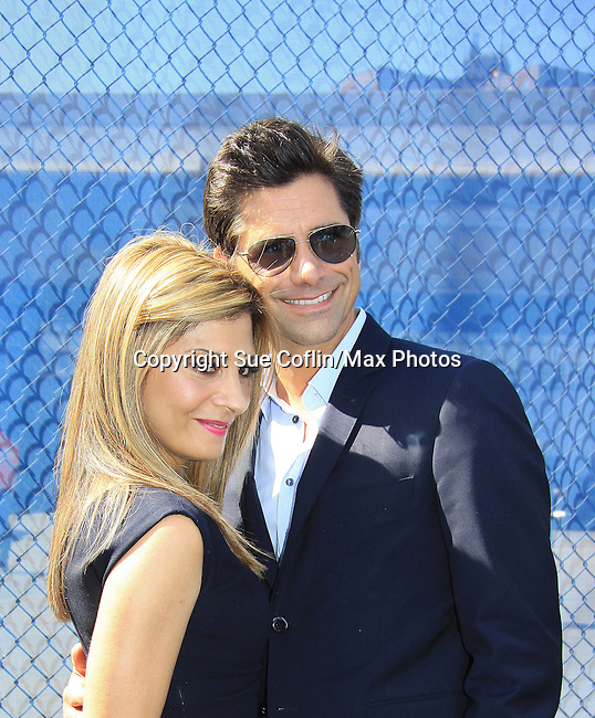 "Callie Thorne & John Stamos (General Hospital ""Blackie"") - Necessary Roughness - USA Network's 2013 Upfront Event with actors from White Collar, Psych, Necessary Roughness, Royal Pains, Suits, Burn Notice, Covert Affairs and now joined by Modern Family on May 16, 2013 at Pier 36, New York City, New  (Photo by Sue Coflin/Max Photos)"
