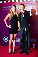 HAIKOU, CHINA - OCTOBER 29:  Spanish golfer Belen Mozo (L) and Hong Kong actor Simon Yam attend red carpet during day three of the Mission Hills Start Trophy tournament at Mission Hills Resort on October 29, 2010 in Haikou, China.  Photo by Victor Fraile / studioEAST
