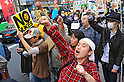 Tokyo, Japan - April 15: A group of people shouted against nuclear power plants during a demonstration at streets of Ikebukuro, Toshima, Tokyo, Japan on April 15, 2012. This was the first time in the big city and organized by a local couple, Mr. and Mrs. Makabe. It was promoted via twitter and its blog, and approximately 250 people showed up.