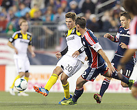 Columbus Crew midfielder Wil Trapp (20) passes the ball.  In a Major League Soccer (MLS) match, the New England Revolution (blue) defeated Columbus Crew (white), 3-2, at Gillette Stadium on October 19, 2013.