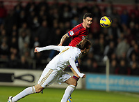 Sunday, 28 November 2012<br /> Pictured: Michu of Swansea (FRONT) misses a header.<br /> Re: Barclays Premier League, Swansea City FC v West Bromwich Albion at the Liberty Stadium, south Wales.