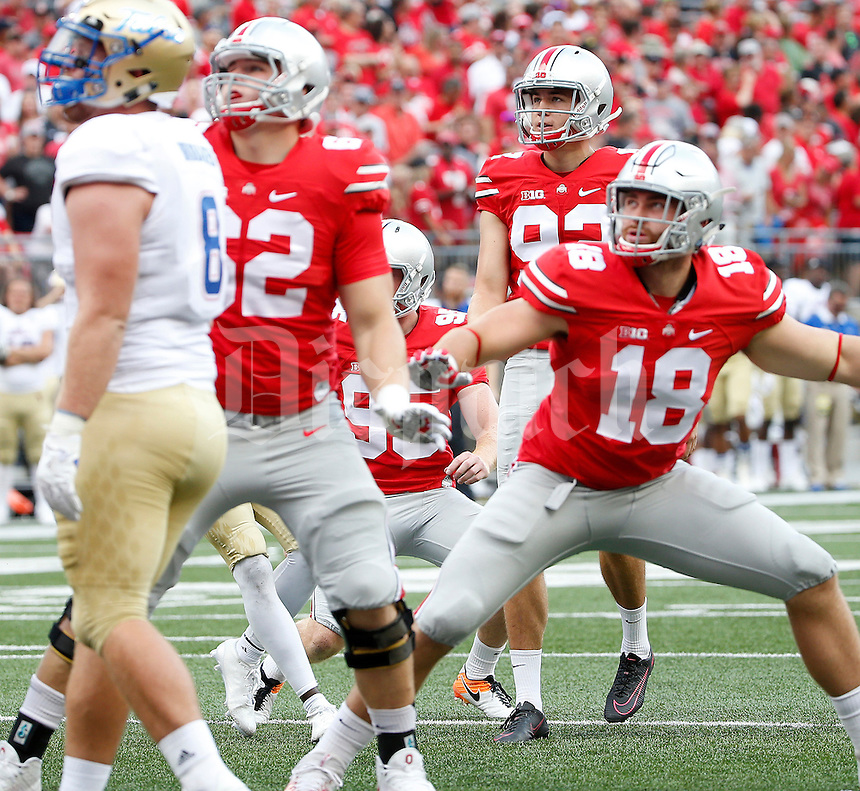 Ohio State Buckeyes place kicker Tyler Durbin (92) watches an extra point during the second quarter of the NCAA football game between the Ohio State Buckeyes and the Tulsa Golden Hurricane at Ohio Stadium on Saturday, September 10, 2016. (Columbus Dispatch photo by Jonathan Quilter)