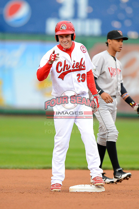 Peoria Chiefs first baseman Patrick Wisdom #29 points to manager Dann Bilardello (not pictured) after hitting a double during a game against the Wisconsin Timber Rattlers on May 25, 2013 at Dozer Park in Peoria, Illinois.  Peoria defeated Wisconsin 6-0.  (Mike Janes/Four Seam Images)