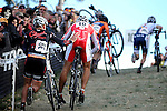 October 31, 2010:  Three-time Danish cyclocross champion, Joachim Parbo (10), gets a helping hand up the run-up during the 2010 Boulder Cup Cyclocross Championship, Boulder, Colorado.