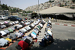 Palestinians attend Friday prayers at the protest tent in the Silwan neighborhood in East Jerusalem on July 8,2011 as Palestinian protesters gather for a demonstration. Photo by Mahfouz Abu Turk