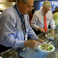 Michael Flaherty (L) picks food from the salad bar in the cafeteria at the Pitney Bowes headquarters in Stamford, CT, United States, 7 October 2008.