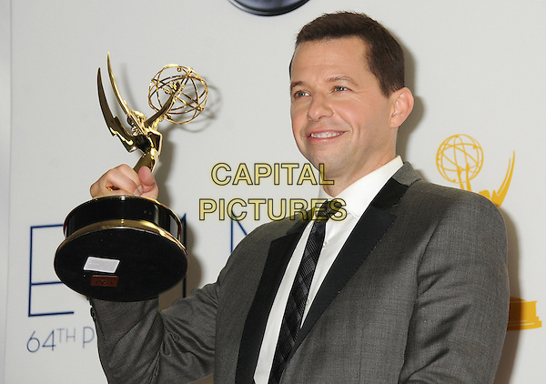 Jon Cryer.64th Primetime Emmy Awards - press room - held at Nokia Theatre L.A. LIVE, Los Angeles, California, USA..23rd September 2012.pressroom emmys half length trophy winner black suit grey gray tie white shirt .CAP/ADM/BP.©Byron Purvis/AdMedia/Capital Pictures.