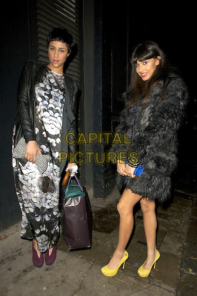 Zawe Ashton and Jameela Jamil.The InStyle Best Of British Talent party, Shoreditch House, Ebor St., London, England..January 26th, 2012.full length white black dress print purple clutch bag shoes yellow fur.CAP/PP/CB.©Cliff Bass/People Press/Capital Pictures