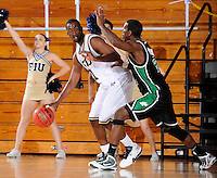 6 February 2010:  FIU's Cedric Essola (21) is defended by North Texas' George Odufuwa (4) in the first half as the North Texas Mean Green defeated the FIU Golden Panthers, 68-66, at the U.S. Century Bank Arena in Miami, Florida.