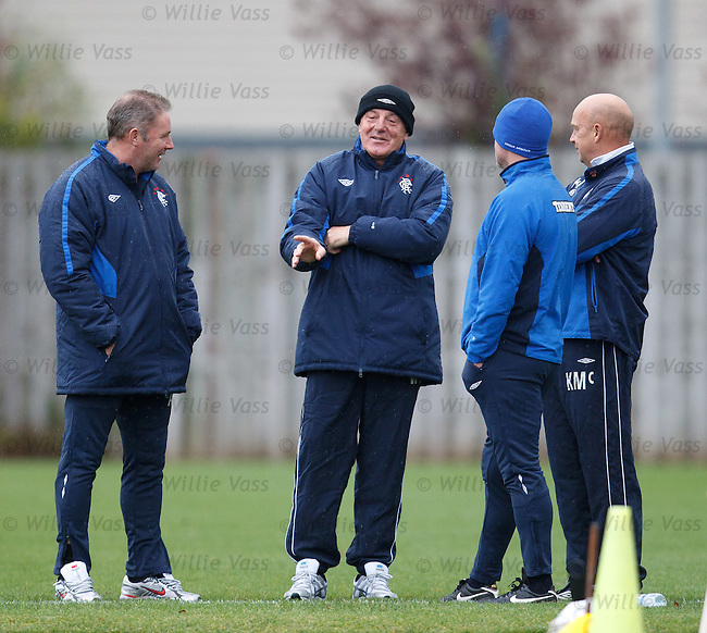 Walter Smith joking and laughing with his assistants