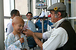 "Cris L'ariste an Israeli  medical clown who works in Hadassah and he is a member of a group call ""Dream Doctor"", plays with Anwar Ibrahim, 3, from the Arab Israeli town of Abu Gosh, at the Oncology Day Care unit at Hadassah Ein Karem hospital. Photo by Quique Kierszenbaum."