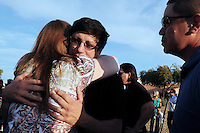 """Gilbert, Arizona – Friends and family of the Mederos Family gathered to hold a memorial for the four victims of the Gilbert Massacre occurred on May 2, 2012. According to Gilbert Police, Lisa Mederos, Amber Mederos, baby Lilly Mederos, and Jim Hiott (Amber's fiancé) were all killed by notorious white supremacist and Neo-Nazi Jason """"J.T."""" Ready before taking his own life. In this image, friends and family comfort Hugo Mederos (being hugged). Mederos is the ex-husband of Lisa Mederos, father of Amber Mederos, and grandfather of baby Lilly Mederos is comforted by family and friends at the memorial. He lives in the state of Florida. Photo by Eduardo Barraza © 2012"""