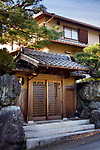 Modern Japanese private residential house with the front gate built in a traditional style. Uji, Kyoto prefecture, Japan 2017.