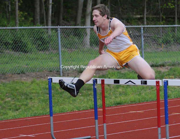 WOODBURY, CT-11 MAY 2010-051110IP15- Brian Burr of Thomaston High School competes in the 300 intermediate hurdles and came in first place, during a track meet at Nonnewaug High School in Woodbury on Tuesday involving Thomaston High School, Gilbert High School and Nonnewaug High School.<br /> Irena Pastorello Republican-American