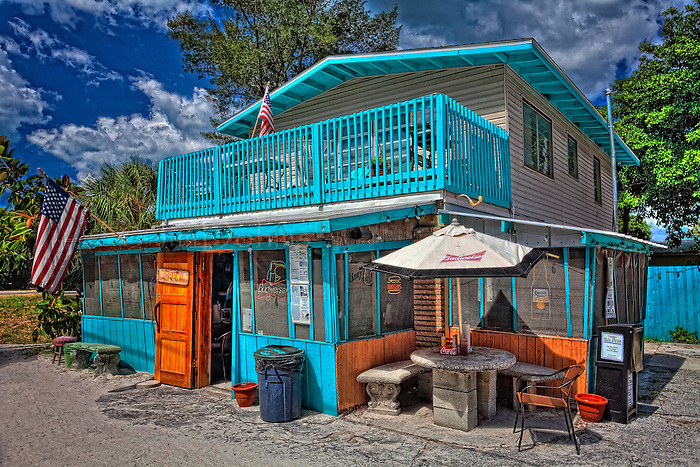 Skinny's Place is located across the street from Holmes Beach on Anna Maria Island. It's known for its classic  cheeseburgers (Skinny's) and double cheeseburgers (Fatties). Cold beer on tap.