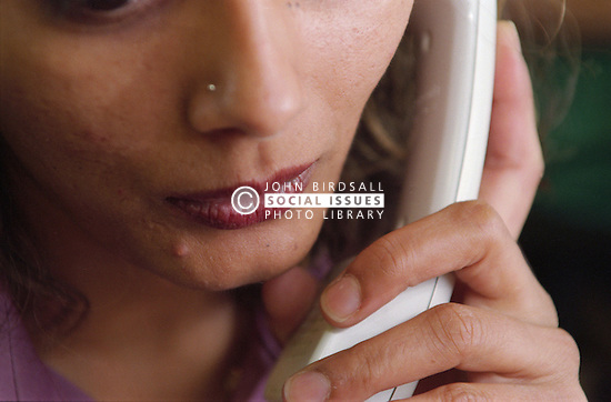 Close up of young woman using telephone,
