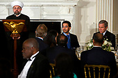 Washington, D.C. - October 16, 2006 -- The Imam Tala Eid, of the Islamic Institute of Boston gives a blessing following remarks by United States President George W. Bush at the annual Iftaar dinner for Muslim leaders in the State Dining Room of the White House.  <br /> Credit: Jay L. Clendenin - Pool via CNP
