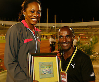 Sanya Richards accepting her 2nd. place award from Donald Quarrie former Olympian. Sanya ran 51.12sec. at the Jamaica International Invitational Meet held at the National Stadium on Saturday, May 2nd. 2009. Photo by Errol Anderson, The Sporting Image.net