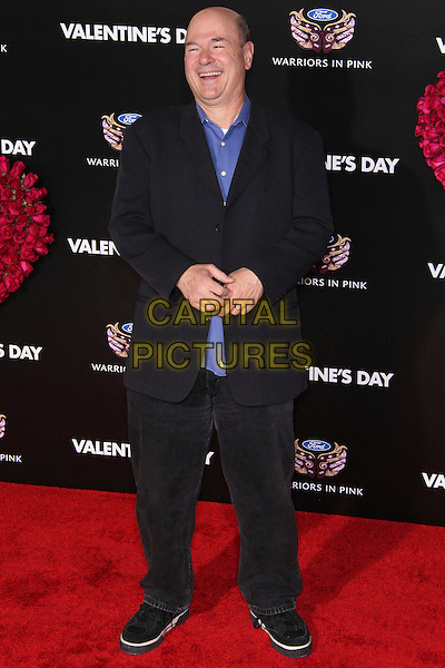 "LARRY MILLER.Arrivals to the world premiere of ""Valentine's Day"" at Grauman's Chinese Theater in Hollywood, California, USA. .February 8th, 2010. .full length black suit blue shirt trainers jacket .CAP/CEL.©CelPh/Capital Pictures"