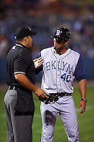 Brooklyn Cyclones hitting coach Yunir Garcia (40) talks with umpire Jose Matamoros in between innings during a game against the Tri-City ValleyCats on September 1, 2015 at Joseph L. Bruno Stadium in Troy, New York.  Tri-City defeated Brooklyn 5-4.  (Mike Janes/Four Seam Images)