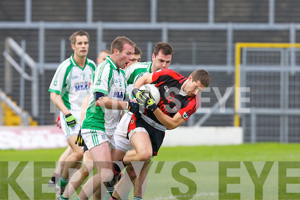 Kieran Dineen Na Gaeil tries to stop Paul O'Connor Kenmare during the Junior Club Championship final in Fitzgerald Stadium on Saturday