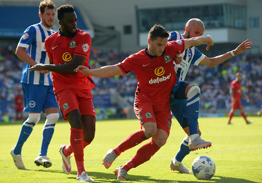 Blackburn Rovers' Craig Conway battles with Brighton and Hove Albion's Bruno Saltor<br /> <br /> Photographer Ian Cook/CameraSport<br /> <br /> Football - The Football League Sky Bet Championship - Brighton and Hove Albion v Blackburn Rovers - Saturday 22nd August 2015 - American Express Community Stadium - Brighton<br /> <br /> &copy; CameraSport - 43 Linden Ave. Countesthorpe. Leicester. England. LE8 5PG - Tel: +44 (0) 116 277 4147 - admin@camerasport.com - www.camerasport.com