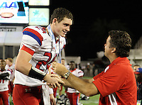 Manatee Hurricanes quarterback Cord Sandberg #24 receives congratulations from principal Bob Gagnon after the Florida High School Athletic Association 7A Championship Game at Florida's Citrus Bowl on December 16, 2011 in Orlando, Florida.  Manatee defeated First Coast 40-0.  (Mike Janes/Four Seam Images)