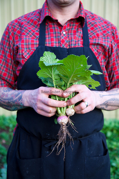 Ned Ludd, a restaurant in NE Portland, where nearly every dish is cooked in the restaurant's wood burning oven. Chef/Co-owner Jason French stands in the organic community garden behind the restaurant.
