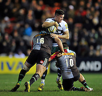 Freddie Burns of Leicester Tigers is double-tackled by Joe Gray and Ben Botica of Harlequins. Aviva Premiership match, between Harlequins and Leicester Tigers on February 19, 2016 at the Twickenham Stoop in London, England. Photo by: Patrick Khachfe / JMP