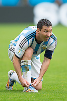 Lionel Messi of Argentina ties his laces