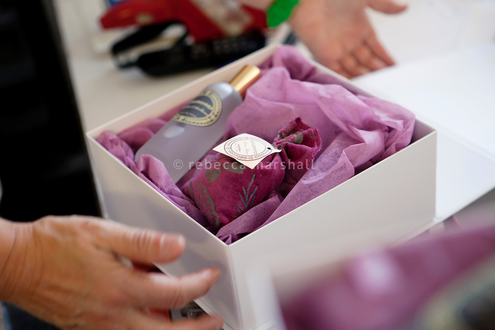 A worker packs perfume products into a presentation box at the Galimard perfume factory and visitor centre, Grasse, France, 3 May 2013