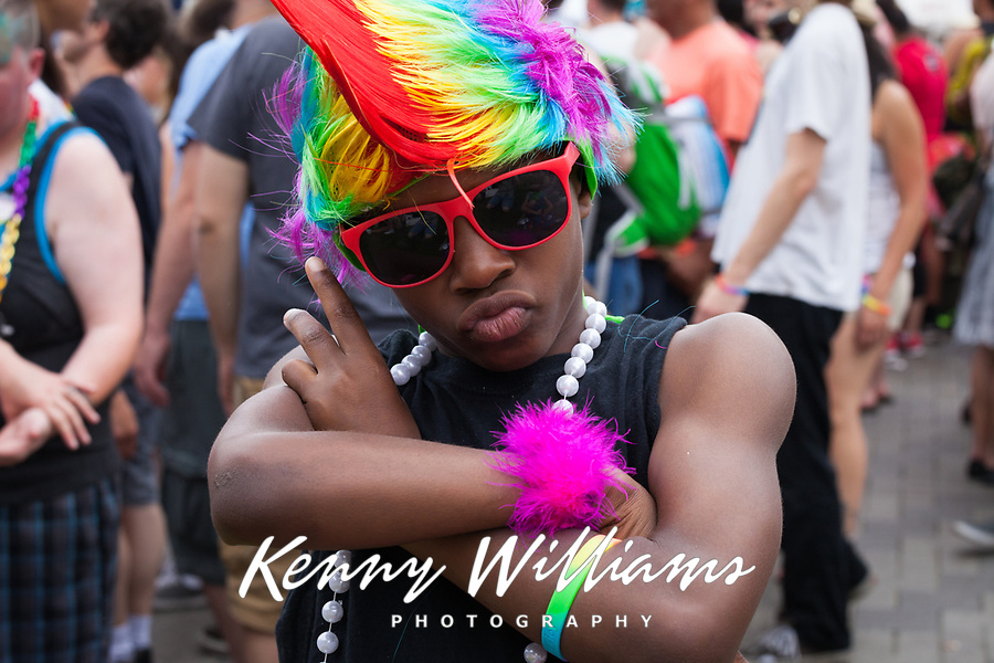 Boy wearing rainbow colored mohawk, Seattle PrideFest 2015, Pride Festival, Washington, USA.