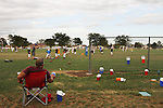 CHAD PILSTER &bull;&nbsp;Hays Daily News<br /> <br /> Parents watch their kids on Tuesday, September 10, 2013, during practice of the third grade Gamblers of the Hays Football Association  at Aubel-Bickle Park in Hays, Kansas.