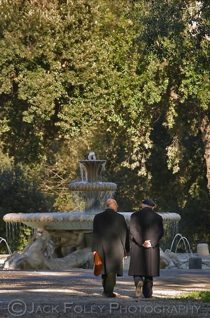Walking with a friend inside the Villa Borghese towards the Fountain of the Sea Horses, Rome, Italy