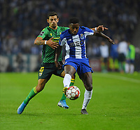 27th October 2019; Dragao Stadium, Porto, Portugal; Portuguese Championship 2019/2020, FC Porto versus Famalicao; Wilson Manafá of FC Porto shoots as he is challenged by Rúben Lameiras of Famalicao