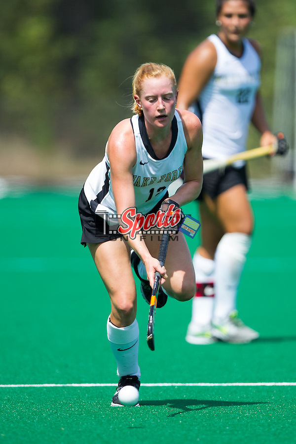 Tyra Clemmenson (12) of the Wake Forest Demon Deacons brings the ball up the field during second half action against the Davidson Wildcats at Belk Turf Field on September 7, 2014 in Winston-Salem, North Carolina.  The Demon Deacons defeated the Wildcats 3-0.  (Brian Westerholt/Sports On Film)