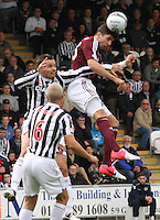 Callum Paterson wins the aerial duel with Lee Mair in the St Mirren v Heart of Midlothian Clydesdale Bank Scottish Premier League match played at St Mirren Park, Paisley on 15.9.12.
