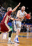 BROOKINGS, SD - JANUARY 31:  Zach Horstman #24 from South Dakota State University passes the ball to a teammate while being guarded by Nate Engesser #33 from Denver in the first half of their game Saturday afternoon at Frost Arena in Brookings. (Photo by Dave Eggen/Inertia)