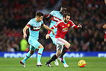 Juan Mata of Manchester United bursts past West Ham's Aaron Cresswell - Manchester United vs West Ham United - Barclay's Premier League - Old Trafford - Manchester - 05/12/2015 Pic Philip Oldham/SportImage