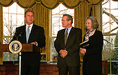 United States Secretary of Defense Donald H. Rumsfeld and his wife Joyce listen as President George W. Bush comments on Rumsfeld's qualifications for the job after he was sworn in as the 21st secretary of Defense in a ceremony at the White House Oval Office on January 26, 2001.  <br /> Mandatory Credit: Robert D. Ward / DoD via CNP