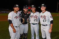 Tri-City ValleyCats pitchers Zac Person (29), Ralph Garza (41) and Kevin McCanna (47) pose with catcher Anthony Hermelyn (7) after a game against the Aberdeen Ironbirds on August 6, 2015 at Ripken Stadium in Aberdeen, Maryland.  Tri-City defeated Aberdeen 5-0 as the trio combined to throw a no-hitter.  (Mike Janes/Four Seam Images)