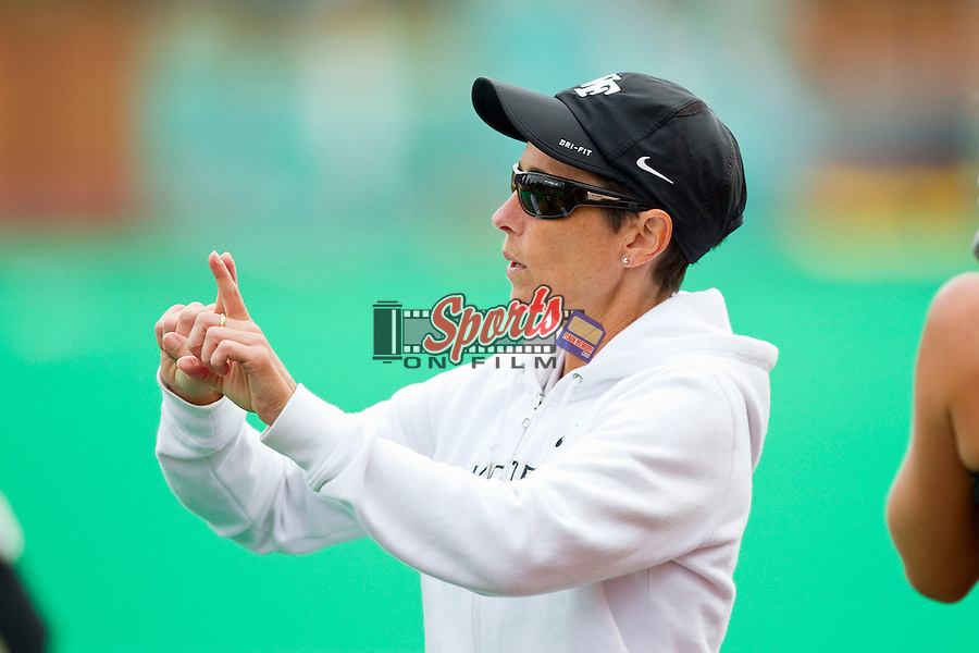 Wake Forest Demon Deacons head coach Jennifer Averill talks with her team during a time out in the match against the Louisville Cardinals at Kentner Stadium on October 14, 2012 in Winston-Salem, North Carolina.  The Cardinals defeated the Demon Deacons 2-1.  (Brian Westerholt/Sports On Film)