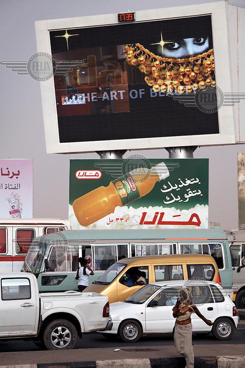 Giant advertising screens line Khartoum's main transport route near the city's airport.