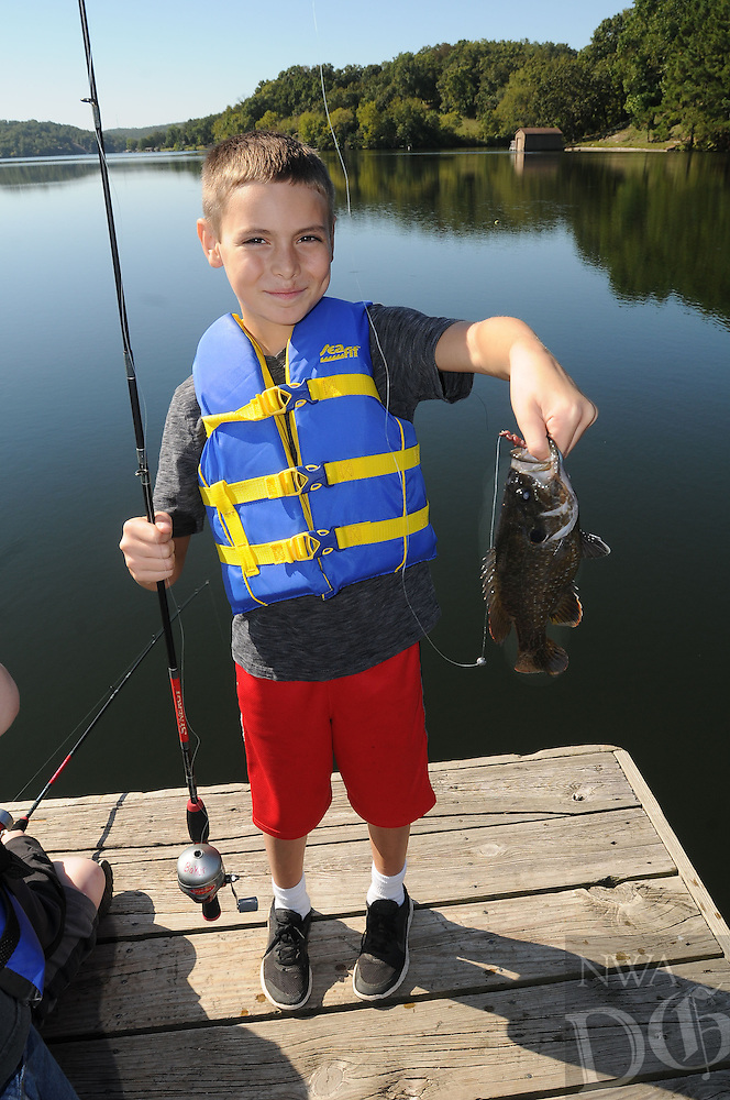 NWA Democrat-Gazette/FLIP PUTTHOFF <br /> Seth Shuck shows a big bluegill he caught Sept. 30 2016 while fishing at Lake Windsor with the Bella Vista Fly Tyers.