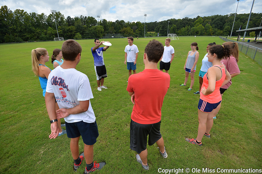 Ole Miss Ultimate frisbee team member Amit Tzivion gives Honors College freshmen tips on how to best catch a frisbee when playing ultimate. Photo by Robert Jordan/Ole Miss Communications