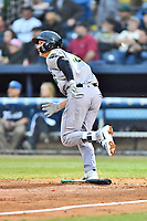 Augusta GreenJackets third baseman Jacob Gonzalez (18) runs to first base during a game against the Asheville Tourists at McCormick Field on April 4, 2019 in Asheville, North Carolina. The GreenJackets defeated the Tourists 9-5. (Tony Farlow/Four Seam Images)