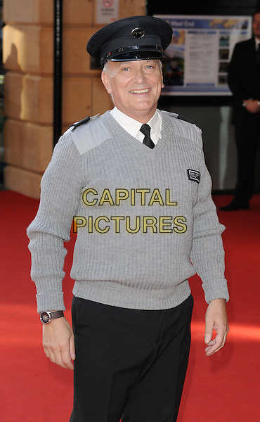 Simon Greenall<br /> attended the &quot;Alan Partridge: Alpha Papa&quot; UK film premiere, Vue West End cinema, Leicester Square, London, England, UK, <br /> 24th July 2013.<br /> half length grey gray jumper uniform hat cap hat black trousers security guard <br /> CAP/CAN<br /> &copy;Can Nguyen/Capital Pictures