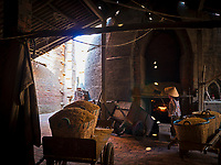 Feeding the large Kiln with Rice Husks and keeping the fire burning for many days. The Brick production and Kiln of Vinh Long in the Mekong Delta, Vietnam.